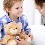 family medicine doctor reviewing teddy bear