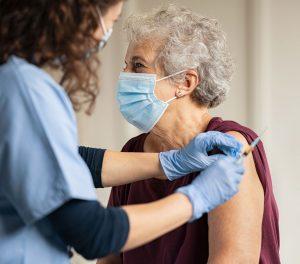 Giving Covid Vaccine to Senior Woman